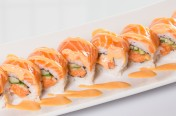 Orange Blossom($14.50) - Spicy salmon, cucumber topped w/salmon, spicy mayo sauce