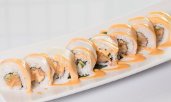 Hamachi Lover($14.50) - Spicy yellow tail, cucumber topped w/yellow tail, spicy mayo sauce.