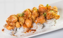 Spicy Cracker($14.50) - California topped w/shrimp tempura, tobiko, green onion, rice cracker, house sauce