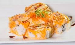 Sushi Pitza($13.95) - Baked salmon, crab meat, avocado, cream cheese topped w/mozzarella cheese, tobiko, green onion, eel sauce