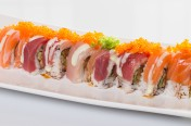 King Kong[Huge]($16.50) - Shrimp tempura, cucumber, spicy tuna topped w/tuna, salmon, yellow tail, tobiko, wasabi mayo sauce