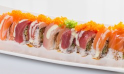 King Kong[Huge]($17.25) - Shrimp tempura, cucumber, spicy tuna topped w/tuna, salmon, yellow tail, tobiko, wasabi mayo sauce