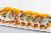 Dragon($15.50) - Shrimp tempura, cucumber topped w/eel, avocado, tobiko, eel sauce