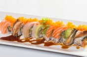 Titanic($14.75) - Soft shell crab, cucumber topped w/eel, salmon, yellow tail, avocado, tobiko, eel sauce