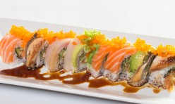 Titanic($15.50) - Soft shell crab, cucumber topped w/eel, salmon, yellow tail, avocado, tobiko, eel sauce