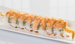 Dancing Ebi($13.75) - Shrimp tempura, cream cheese, cucumber topped w/spicy crab meat, eel sauce