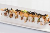 Black Spider($14.75) - Spicy tuna, cucumber topped w/soft shell crab, tobiko, unagi & wasabi mayo sauce