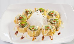 TNT($14.75) - Spicy tuna, eel, cream cheese, cucumber deep fried topped w /jalapeno, house sauce
