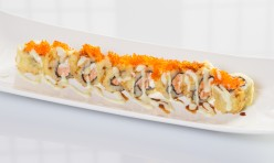 Alaskan Crispy($12.50) - Salmon, cream cheese deep fried topped w/tobiko, eel & wasabi mayo sauce