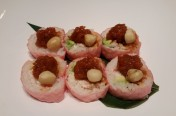 Aloha($12.75) - Crab meat, avocado wrapped w/soy bean paper -  spicy tuna, macadamia net