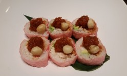 Aloha($13.50) - Crab meat, avocado wrapped w/soy bean paper -  spicy tuna, macadamia net