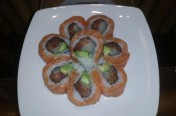Sun flower($14.50) - tuna, yellow tail, salmon, avocado topped with salmon