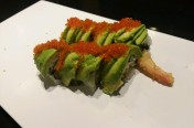 Green Dragon($13.75) - shrimp tempura, cucumber, w/avocado, tobiko, unagi sauce